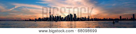 Panoramic view of Toronto city skyline over ontario lake at sunset