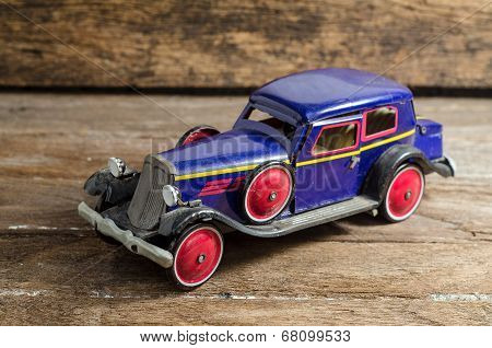Old tin toy on old wood background