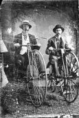 stock photo of penny-farthing  - Vintage black and white tintype of two men on high wheel bicycles - JPG
