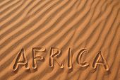 picture of barchan  - Word Africa writen on sand in the dunes of Erg Chebbi in the Sahara Desert - JPG