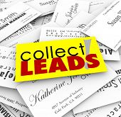 image of clientele  - Collect Leads words on a pile of business cards from new customers and prospects  - JPG