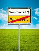 picture of daylight-saving  - An image of Daylight Saving german city sign - JPG