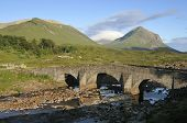 stock photo of na  - Sligachan Old Bridge with Druim na Ruaige  - JPG