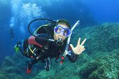 picture of gozo  - Scuba diving instructor leads a group of divers - JPG