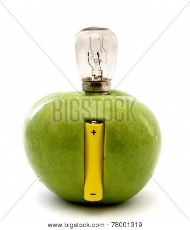 Green Apple With A Lamp And A Battery