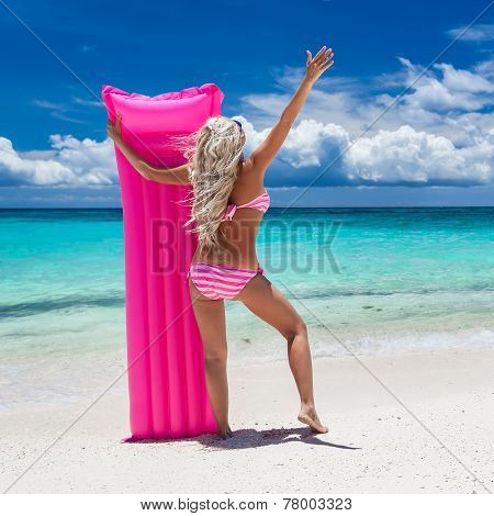 Woman With Pink Swimming Mattress On Tropical Beach