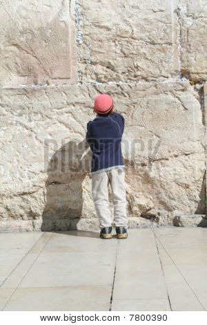 A Young Boy Prays at the Kotel