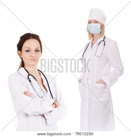Standing woman doctor with stethoscope in a white robe. She stands folding her arms