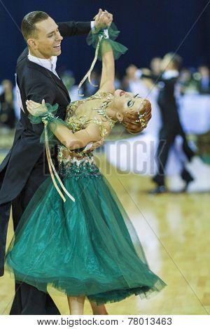 Minsk-belarus, October 5, 2014: Professional Dance Couple Of Roman Lobarev And Dariya Konohova Perfo