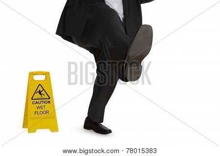 Man In Suit Slipping On Wet Floor