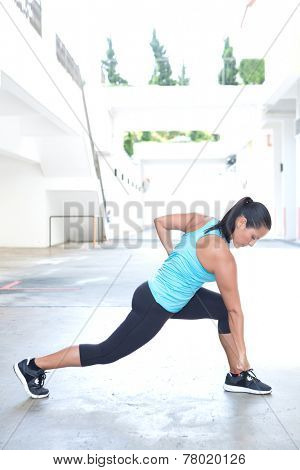 Beautiful hispanic sport woman demonstrating martial art stance , outdoor. Concept of healthy lifestyle.