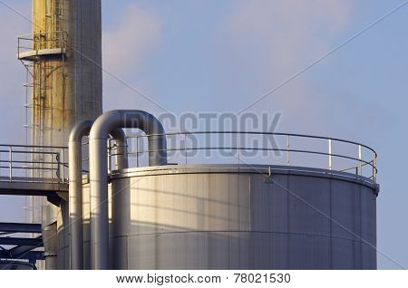 Smokestack and tank of a factory in Zaragoza, Aragon, Spain