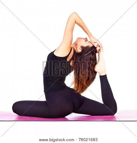 Beautiful woman exercising Eka Pada Rajakapotasana - One Legged King Pigeon pose yoga .