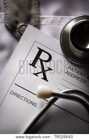Stethoscope And Patient List On Doctor's Smock