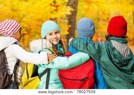 Back of schoolchildren standing in row close