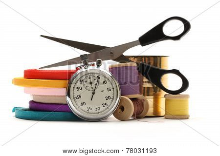 Thread Bobbins, Stopwatch, Scissors And Reels Of Ribbon