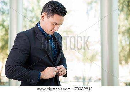 Businessman Buttoning His Jacket
