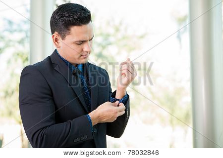 Businessman Fixing Up His Sleeves