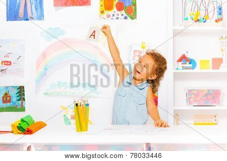 Happy little girl learn first letters