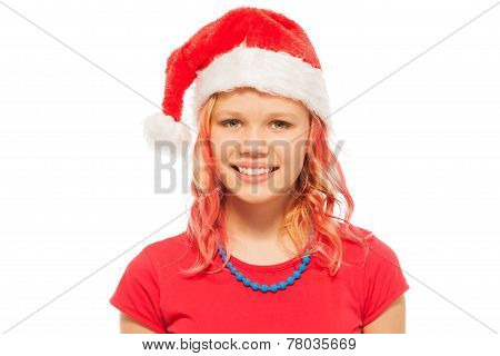 Happy smiling blond girl in Santa Christmas hat