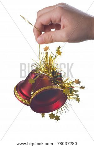 Christmas Background With A Hand Holding A Bell
