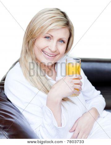Beautiful Woman Drinking An Orange Jus