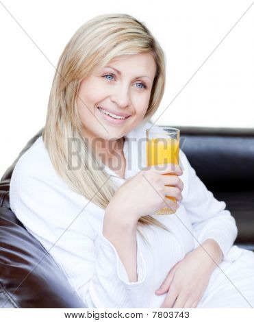 Smiling Woman Drinking An Orange Jus