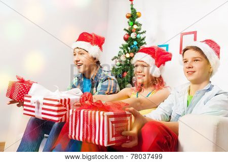 Teen kids with presents on New year eve party