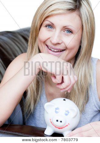 Beautiful Woman Using A Piggybank