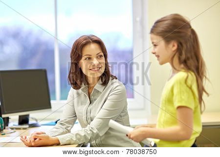 education, elementary school, learning, examination and people concept - school girl with notebook and teacher in classroom