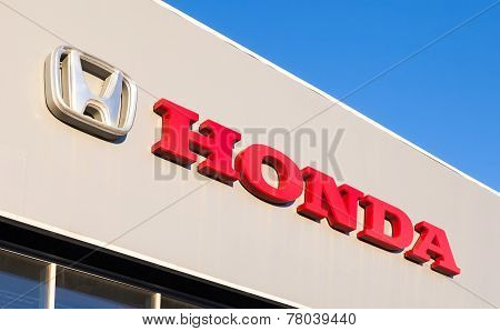 Honda Dealership Sign Against Blue Sky