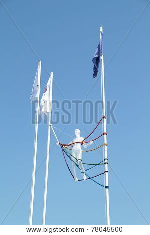 Perm, Russia - Jun 11, 2013: Translucent Mannequin Wrapped Colored Ropes On Flagpoles At Festival Wh
