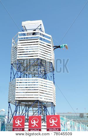 Perm, Russia - Jun 11, 2013: Tower Of Frame With Dummy Going Down Wall At Festival White Nights In P