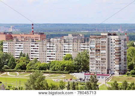 Modern Residential Buildings Surrounded By Green Trees On Sunny Day