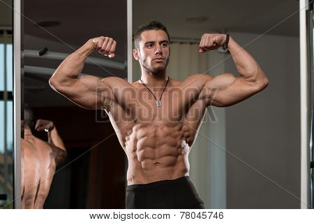 Young Man Performing Front Double Biceps Pose