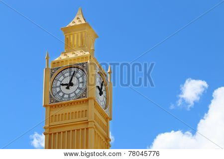 Yellow Layout Of Big Ben Tower On Blue Sky Background On Sunny Day Closeup