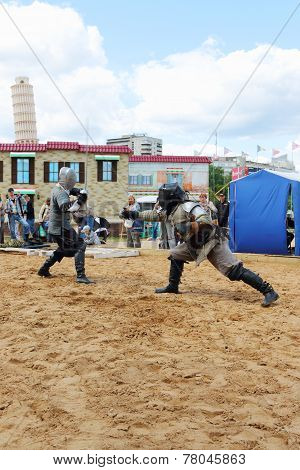 Perm, Russia - June 25, 2014: Two Men Fencing Swords At Festival White Nights