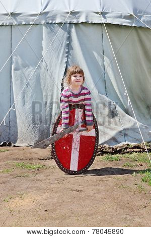 Little Beautiful Girl In Striped Sweater Holding Sword And Shield