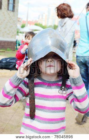 Beautiful Girl In Striped Sweater Wearing Medieval Helmet
