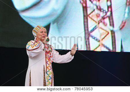 Singer Of Folk Songs In National Dress Singing At Festival White Night