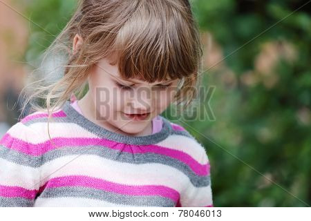 Young Happy Smiling Girl In Striped Sweater Looking Down