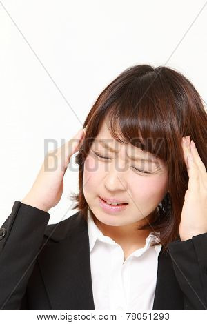 businesswoman suffers from headache