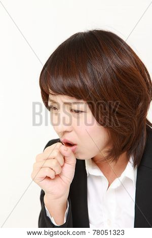 Japanese businesswoman coughing