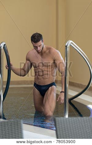 Young Looking Macho Man At Hotel Indoor Pool