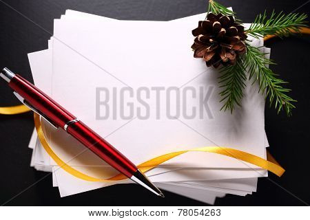 Stack Of Paper Cards And Twig Of Evergreen Fir