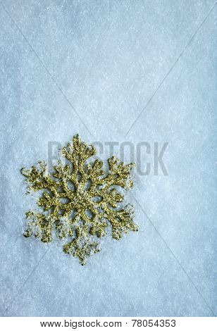 Blue Clear Cristal Snow Surface With One Gold Snowflake