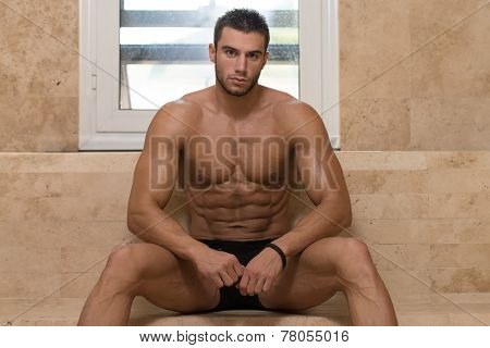 Attractive Man Resting Relaxed In Sauna