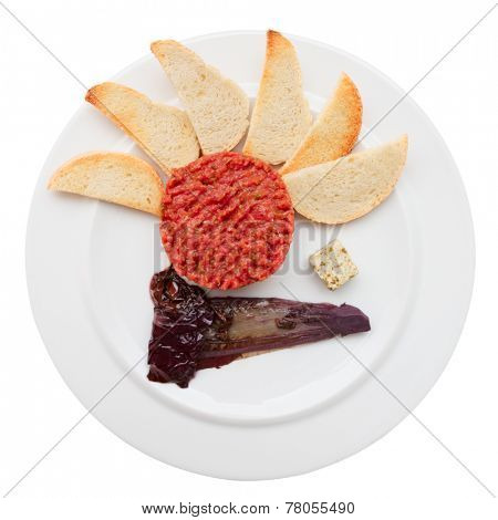 Tartare with toasts and chicory cooked in wine, isolated with clipping path