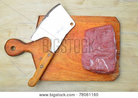 Raw fresh meat and meat cleaver