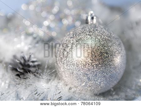 Silvery New Year's ball . Christmas still life